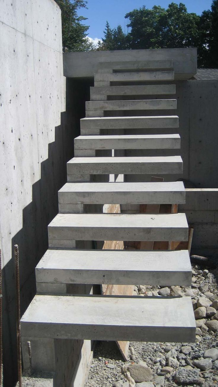 Exterior concrete cantilevered stair frontal overview for Steps to building a new home