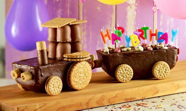 Lokomotive - Für echte Schokotiger: ein Schokoladen-Cake, dekoriert mit Mohrenköpfen, Guetzli und anderen Schleckereien!