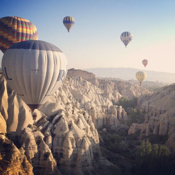 "Ballooning over Cappadocia at Daybreak // Photo and caption by Eric Bloom // It was a cool, clear May morning and we floated for about an hour over Cappadocia's valleys. Cappadocia's famed ""fairy chimneys,"" which come in shades of cream, pink, and orange, are remnants of volcanic activity throughout history. // Location: Goreme, Cappadocia, Turkey"