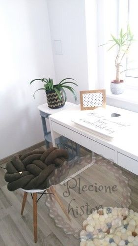 Khaki suede knot pillow and our handmade pompoms carpet.