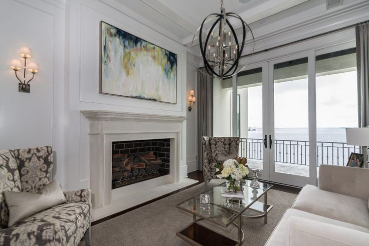 The Contemporary Jewel - Weber Design Group. Living room, fireplace, glass doors, balcony, waterfront.