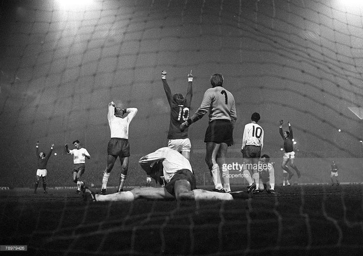 26th February 1968. Denis Law with arms in the air as his Manchester United team mate George Best (out of shot) opens the scoring against Rapid Vienna, European Cup Quarter Final 1st Leg, at Old Trafford,