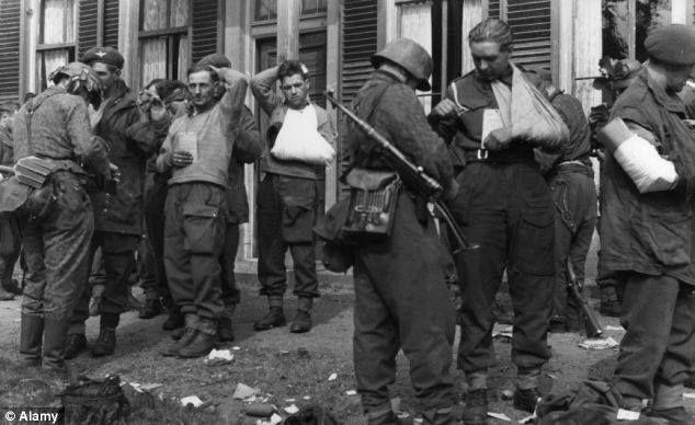 Bitter start being a PoW. British PoWs captured in the suburbs of Arnhem, September 26, 1944.