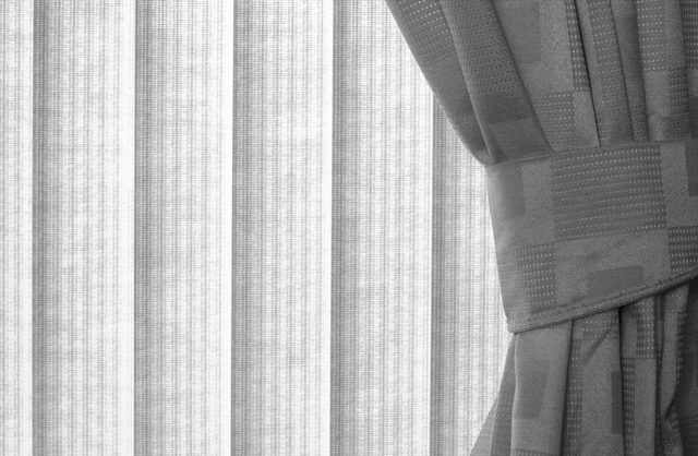 Pairing curtains with vertical blinds softens the sometimes industrial feel of the blinds and adds structure to the often traditional look of curtain panels. But these window...