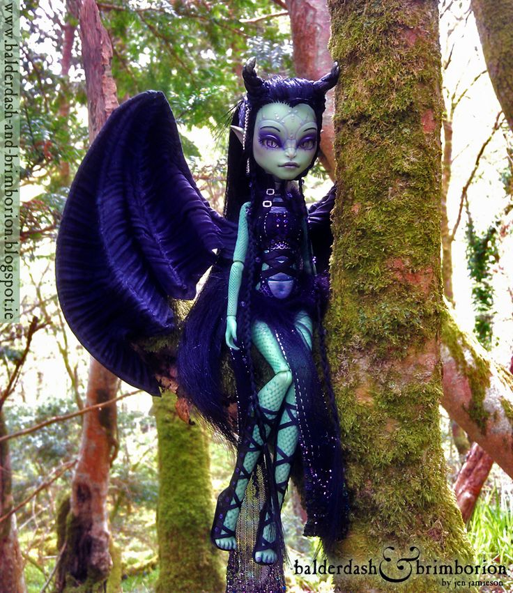 Here is a new doll that I was commissioned to create. She was originally a Monster High CAM Gorgon doll. Full repaint, root, costume, wings built, eyes made from scratch, and ears and horns sculpted and attached.