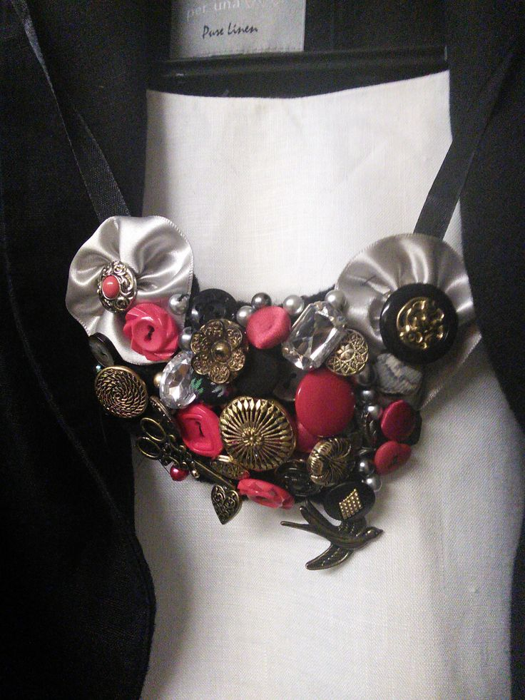 Button, bead and ribbon bib necklace made by me.