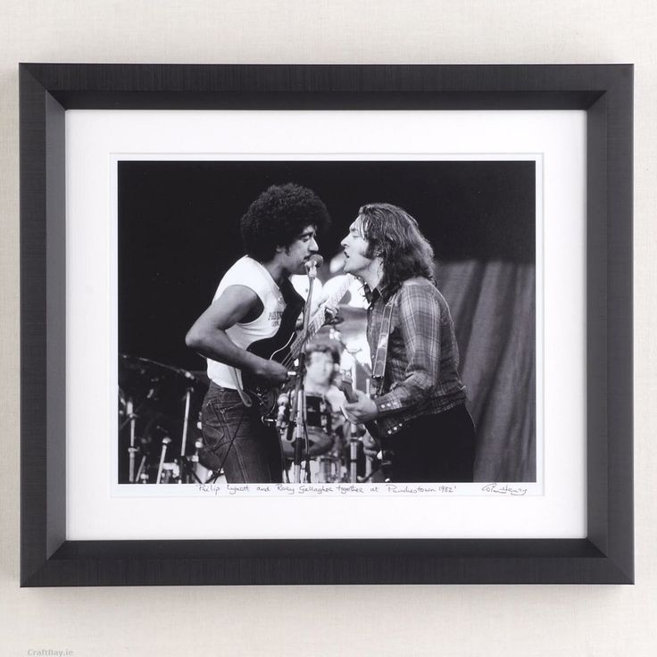 "Philip Lynott and Rory Gallagher performing ""this is the woman"" at Punchestown ,Ireland in 1982.  This is the only photo in existence from this one-off event.  Photo is an open edition print size 10"" x 12"" signed, stamped and framed in black box frame by the photographer Colm Henry.  Delivery  - Unless especially specified I will ship your item 1 - 3 days after payment is made.  Shipping to Ireland € 7.50  Shipping to EU €10.00  Shipping to ..."