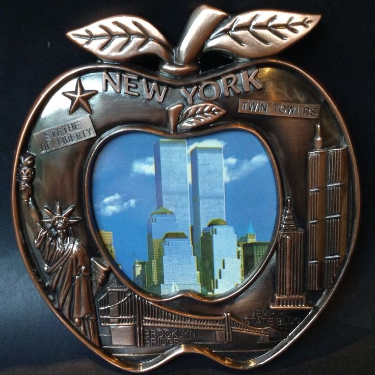 """New York - The Big Apple. Photo Frame souvenir. Twin Towers. Statue Liberty. At widest part frame is 15cm (6""""). Empire State. Picture section in centre is approx 8cm diameter (Apple not circle). 