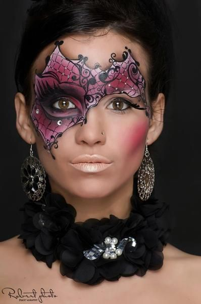 Creative purple and black crystal accented masquerade make-up mask, face painting,
