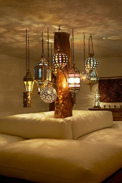 These are gorgeous, so Moorish looking, I can totally envision a room illuminated by these lanterns casting shadows and shapes on the ceiling and walls, an added design feature inherent to the lighting fixtures themselves.