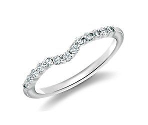 Classic Curved Diamond Wedding Ring in 18k White Gold (1/4 ct. tw.) - i really like this and how it is curved to fit around the main stone. only 680.00 that seems really cheap. at least compared to all the others!