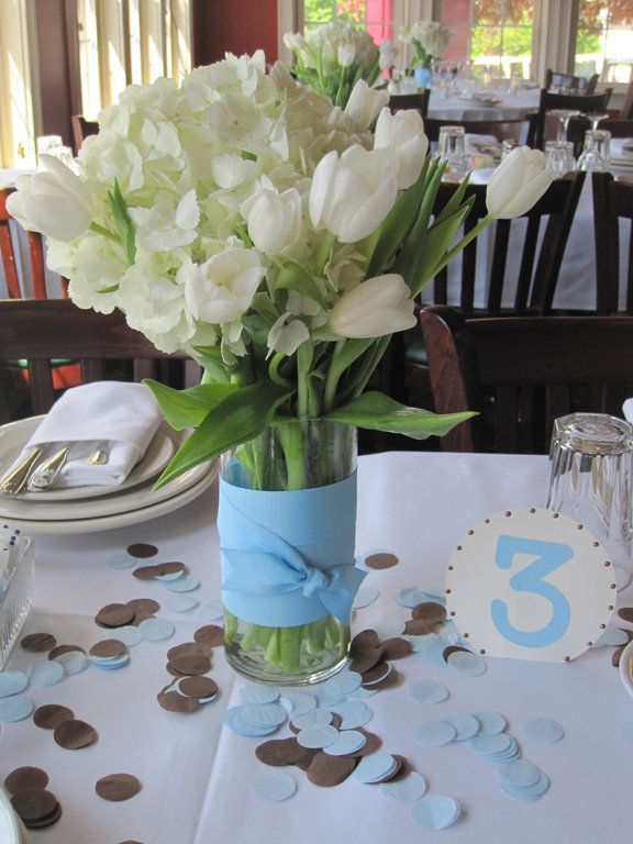 first communion menu ideas | Fresh floral centerpiece with coordinating confetti accents and table ...