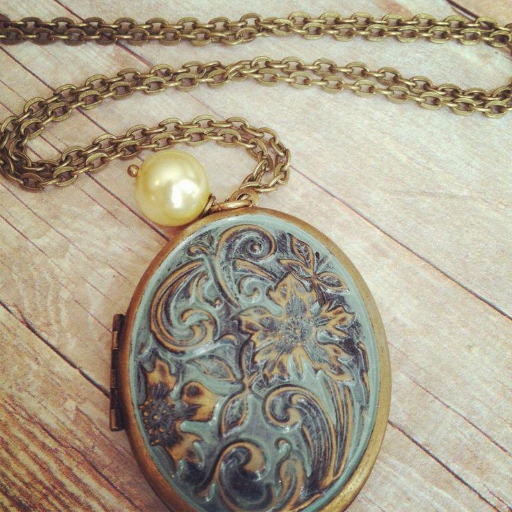 Antique Locket, Floral Patina, Large Locket, Long, Cream Pearl. $27.00, via Etsy.