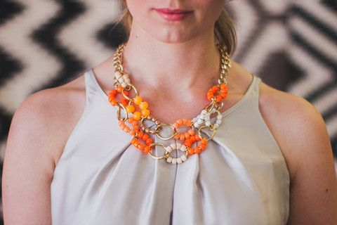 Gorgeous bright orange, bronze, coral, white and gold tone beads liven up a large chunky vintage chain. Hung on large link gold chain.