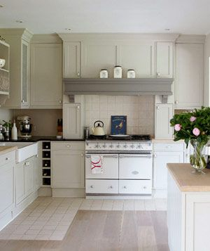 Creamy cabinets, an ivory La Cornue stove, and neutral laminate flooring work together to make this high-traffic zone feel open and uncrowded.: Kitchens Interiors, Kitchens Design, Cabinets Colors, Floors, Interiors Design Kitchens, Gardens Design Ideas, Kitchens Ideas, Neutral Kitchens, White Kitchens