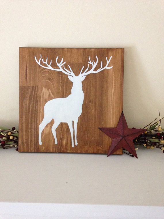 A simple and elegant accent piece for your home or cottage. Measures 12 x 12.  Hand-painted deer in cream on a walnut or antique red stained wood background. Protected with a clear topcoat. Designed to either hang easily on a single nail or to lean on a shelf or mantel.  Our silhouettes are inspired by the animals typically seen around a country home. We welcome custom orders with the animal of your choice. Send us a message to discuss designs