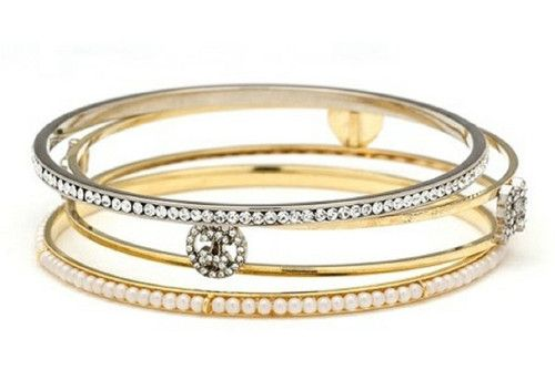 """Juicy Couture """"Icons by the Yard"""" Pave Bangle Set  Sale $88.00. Faceted stones and lustrous faux pearls detail a trio of glittering bangles, each topped with its own feminine accent. Two in 14k gold-plated brass and one in silver-plated brass."""