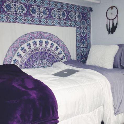 This purple dorm bedding creates such a cute dorm room!