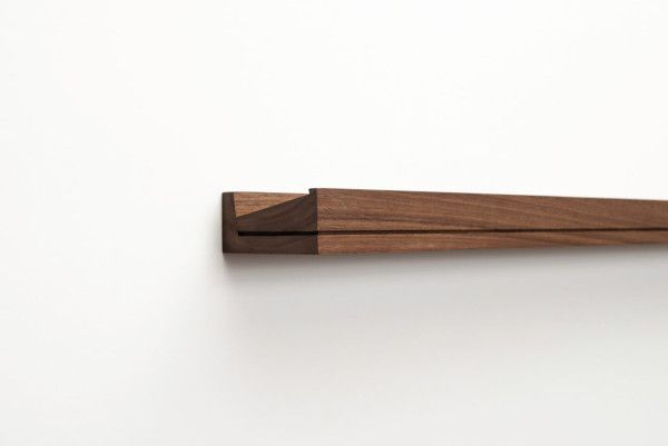 Singular is a wall mounted, hand crafted wood console