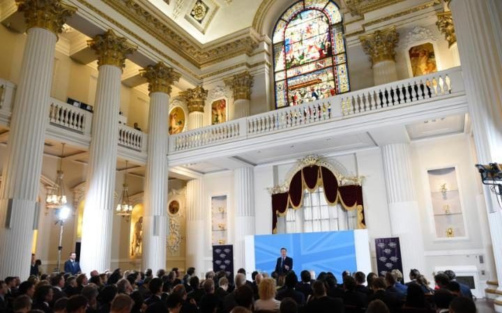 David Cameron gives a pro-EU speech to the World Economic Forum, beneath a…