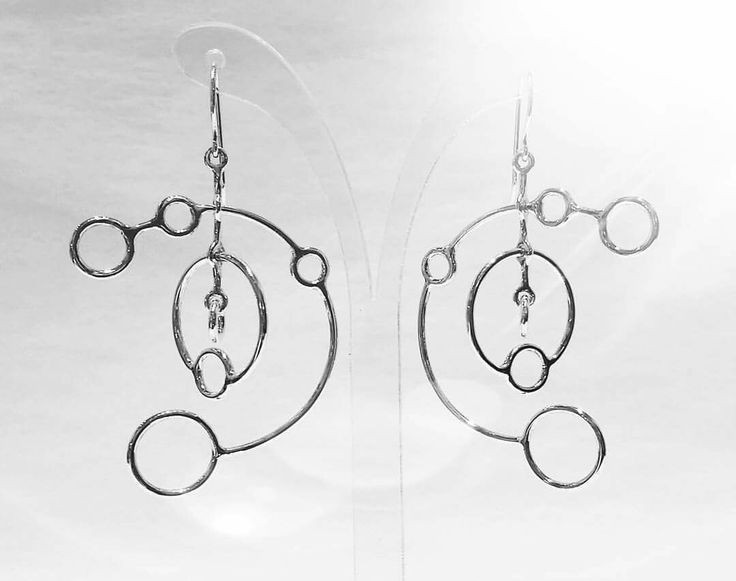Kinetic crop circle earrings for the person in your life that's out of this world! Sterling silver.