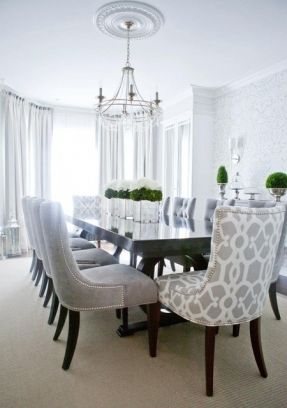 Gray dining room chairs with chrome nail heads and contrasting dining room head chairs in a gray and white trellis print
