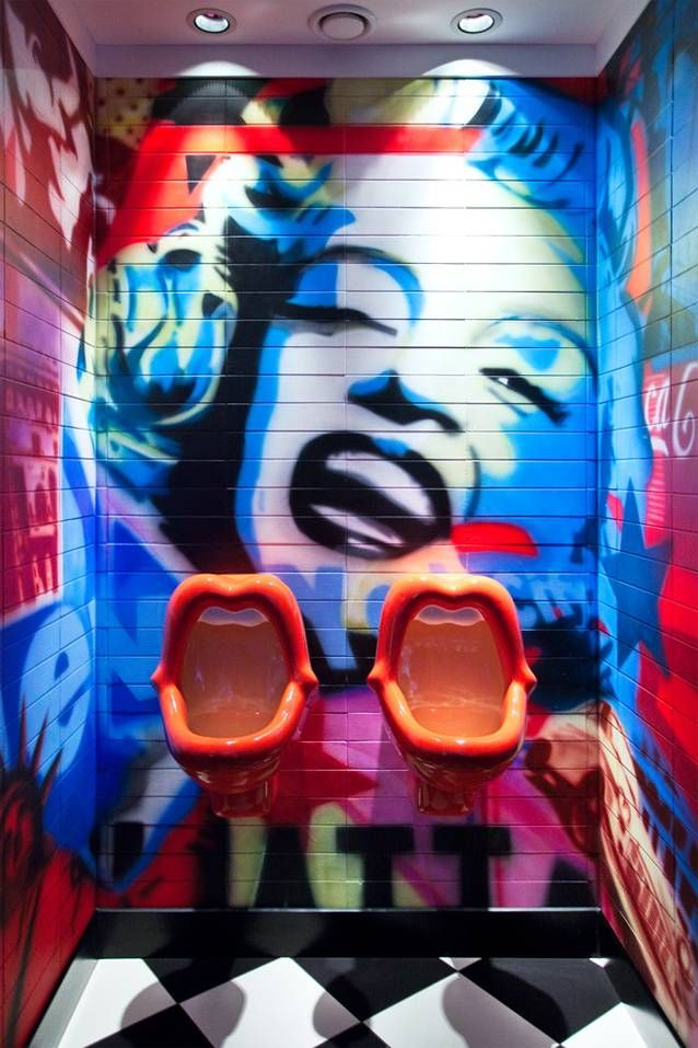 Toilet with colorful Marilyn Monroe wallpainting