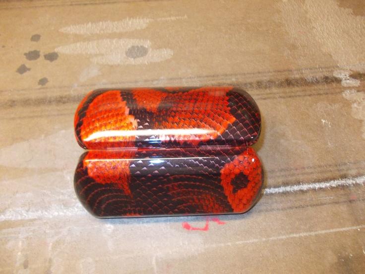 Eyeglass case dipped in Boa.   Hydro graphic snake skin for some custom wheels?