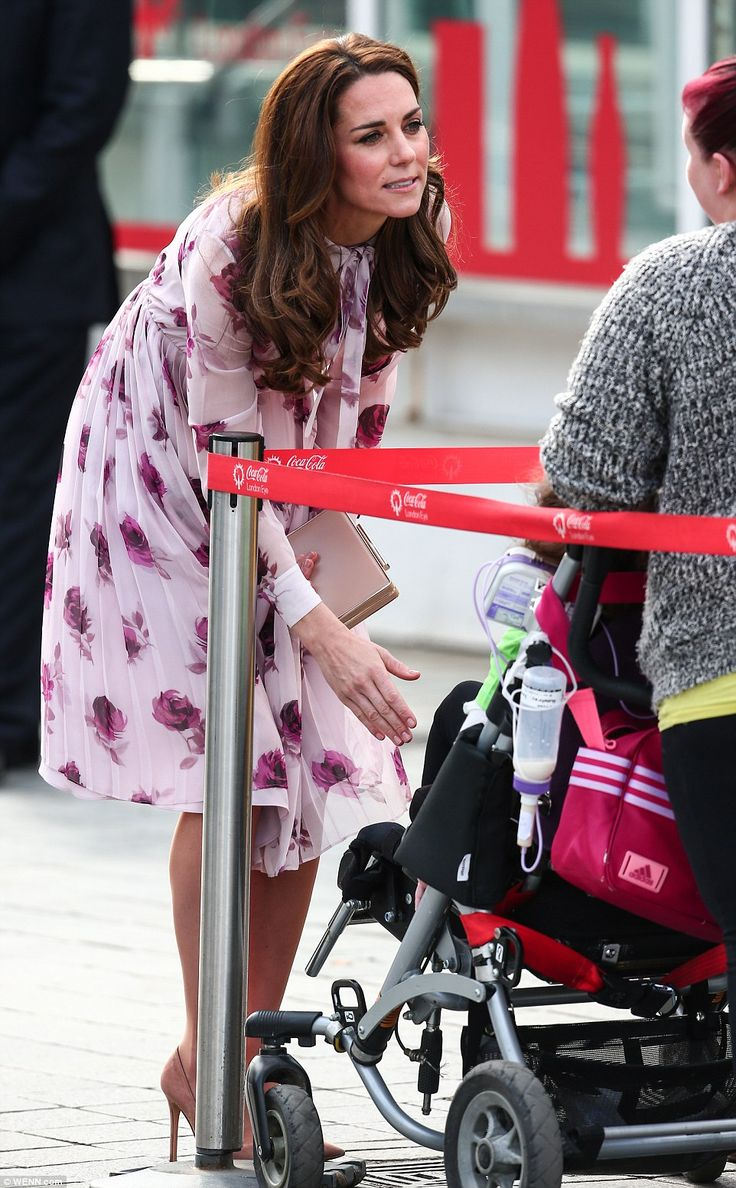 Kate chats to a mother with a young child on London's Southbank following her visit to The London Eye