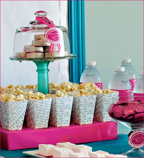 Love the display of popcorn and sweets...gives table new heights....pun intended.