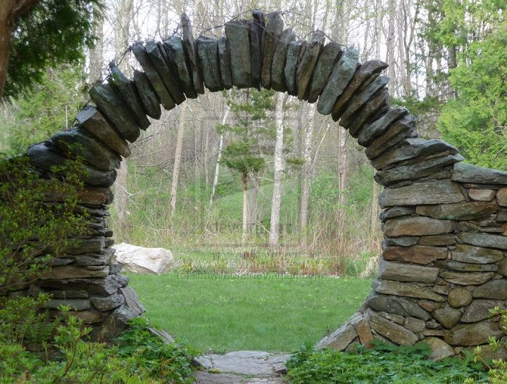 A moon gate rises out of the earth, like the moon rises in the sky, both spheres celebrate the continuous cycle of birth and death...