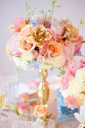Blue, pink, peach and cream flowers in gold candlestick vase from Maine Seasons Events and Floral Fauna | photography by http://corbingurkin.com/