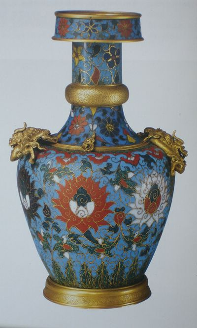 Lamaism cloisonne vase. Lamaism is a branch of buddhism, which is the dominate religion in Mongo and Tibet. This vase bears the very shape of a lamaism pagoda. Notice the carvings on the gold around the neck and bottom rim is very typical Yuan patterns.