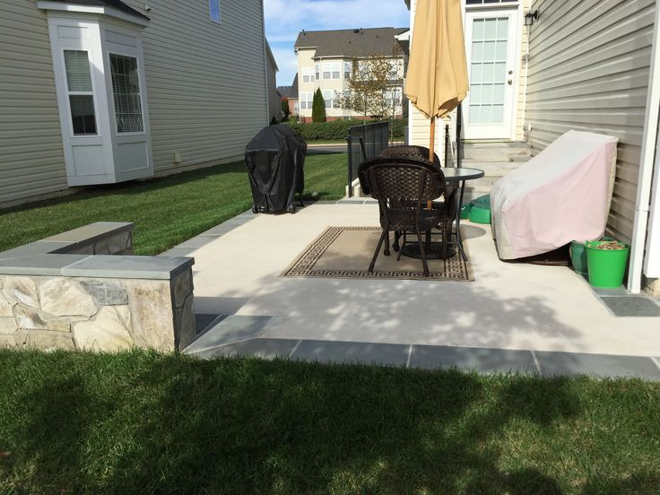 Concrete Patio With A Stone Seating Wall And Flagstone Border In Aldie,  Virginia.