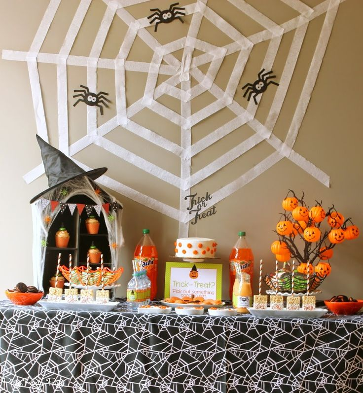 Amazing Halloween party ideas including a DIY spiderweb backdrop and fun party games!