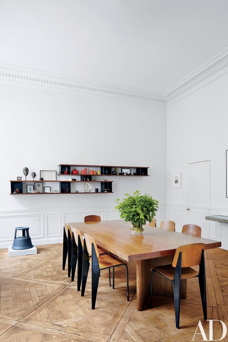 Prouvé Standard school chairs surround the dining room's Jeanneret conference table