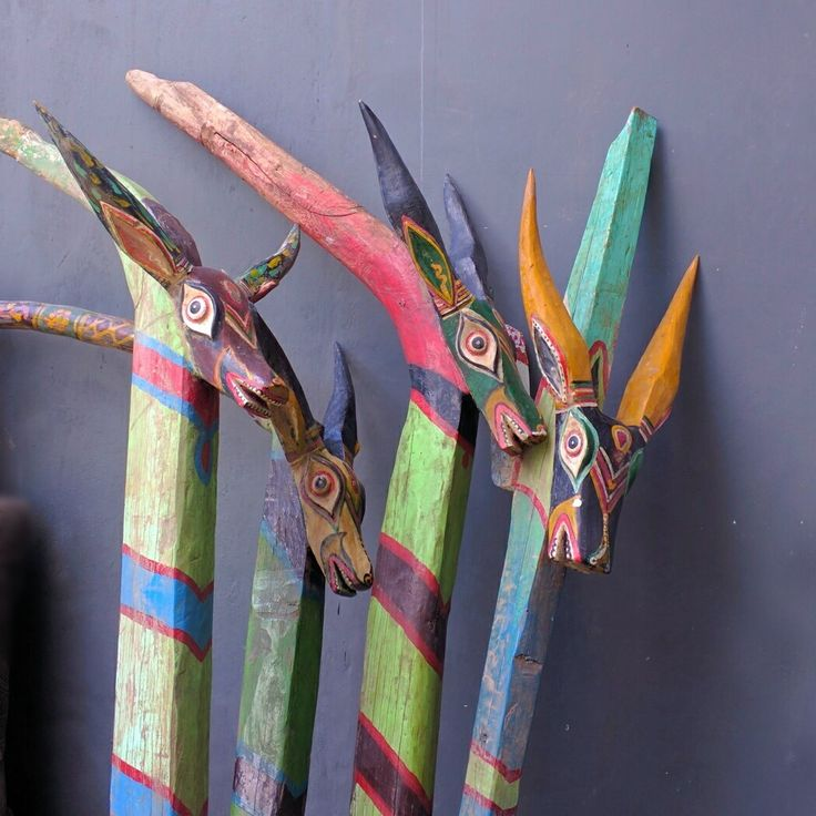 Colorful antique wooden boat decor. www.kulukgallery.com