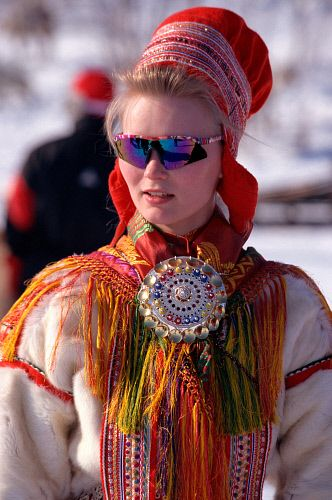 Sami girl wears traditional jewelry and clothes with ...