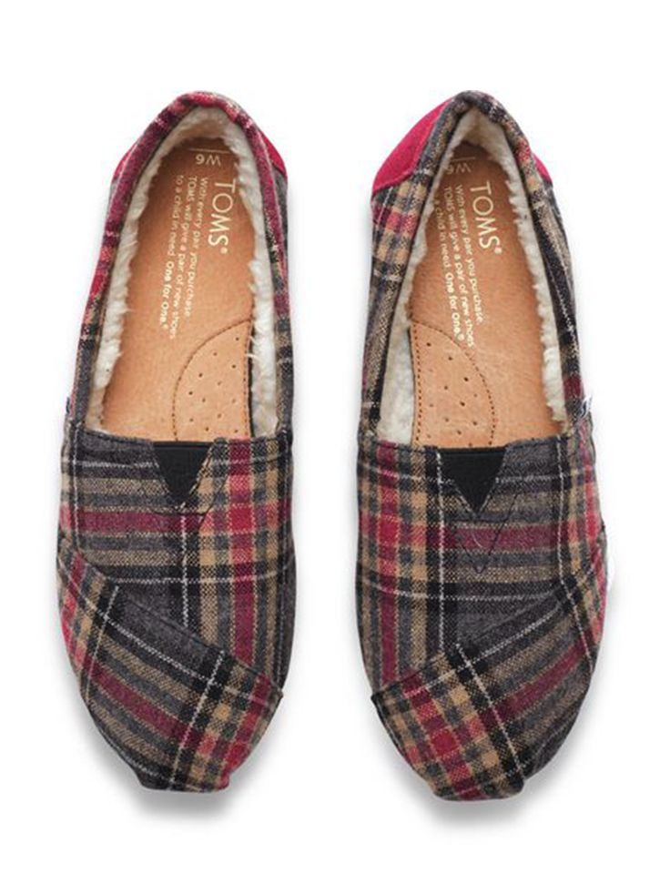 It's the season for plaid! From warm throws to comfy, shearling lined slip-ons, plaid is winter's print. Shown: TOMS women's Pink Plaid Classics