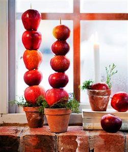 Ljusstake med äpplen