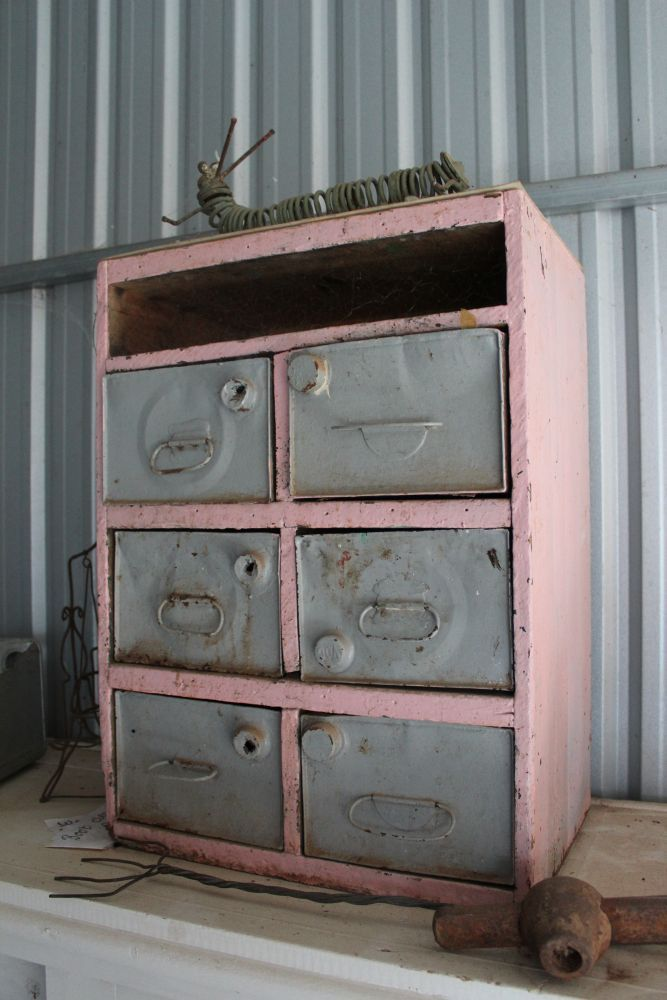 Cupboard with drawers made from petrol cans
