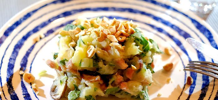 Paksoistamppot met champignons, kaas, spekjes en cashewnoten