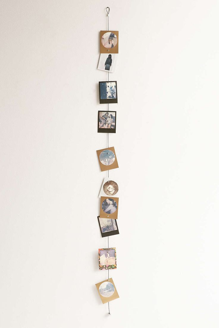 Photo display- could make with dark construction / cardboard paper and a wire cable.