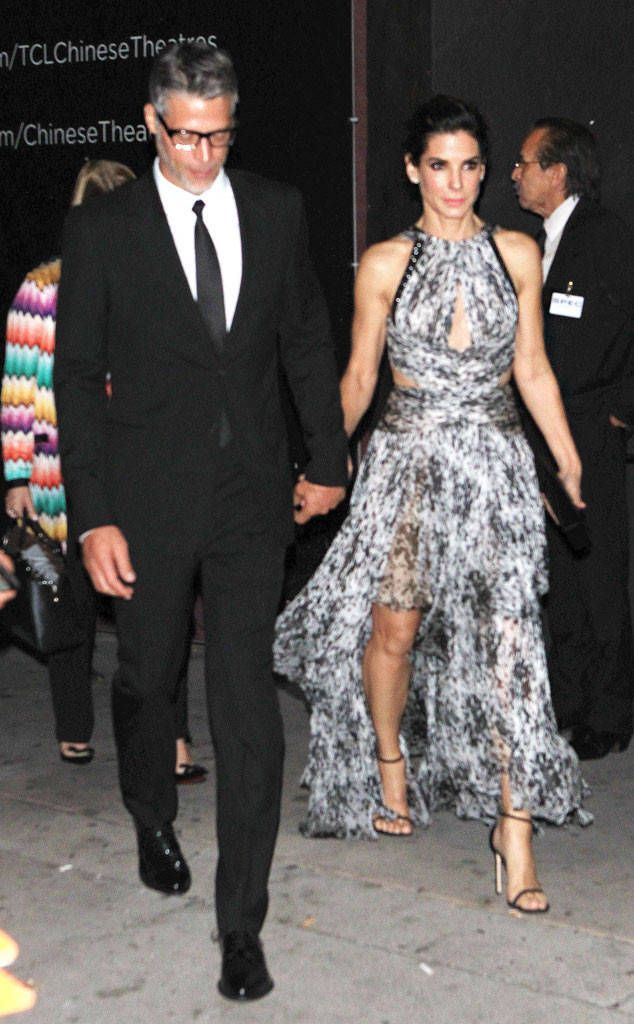 Red Carpet Ready from Sandra Bullock & Bryan Randall's Romance Timeline  Bullock and Randall held hands on their way out of the star-studded premiere for the actress' latest film,Our Brand Is Crisis,on Oct. 26, 2015.It was the first time the Oscar winner had ever taken her dark-haired beau to a work event.