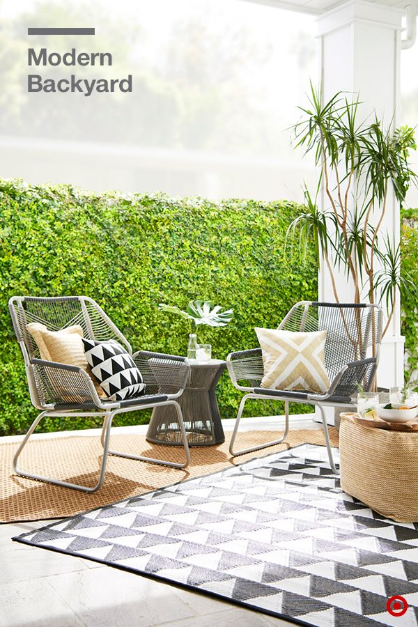 It S Easy To Make Your Backyard And Patio Into A Modern Hangout Layered Outdoor Rugs