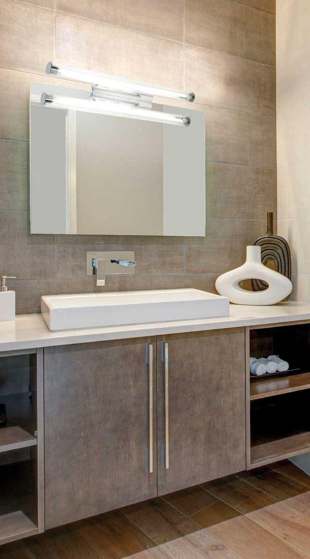 Απλίκα - φωτιστικό τοίχου μπάνιου, λάμπα φθορίου, βάση μεταλλική χρωμίου και γυαλί σατινέ λευκό ή διάφανο PVC. Σειρά Elis από την Viokef. --------------------- Sconce - bathroom wall lamp, fluorescent lamp, with metal chrome base and glass in satin white color or transparent color. #bathroom #bathroomlighting #bathroomdesign #bathroomdecorideas #bathroomideas #bathroomdecor  #papantoniougr #φωτιστικό #μπάνιο