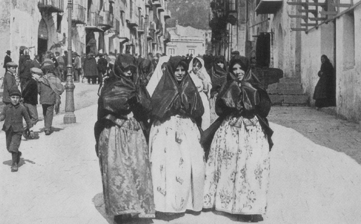 Three Sicilian women in traditional clothes