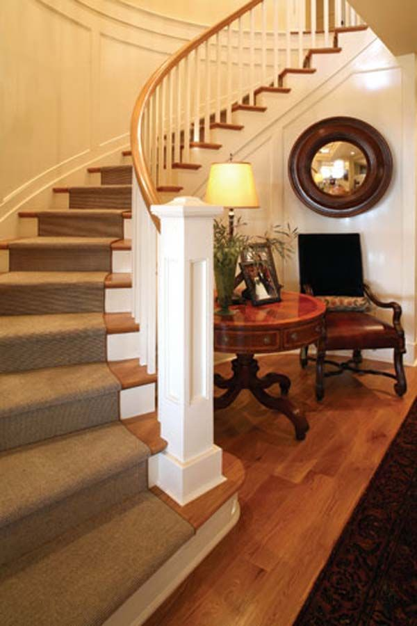 A curved staircase and entry in an elegant home in Bennett Point, Maryland
