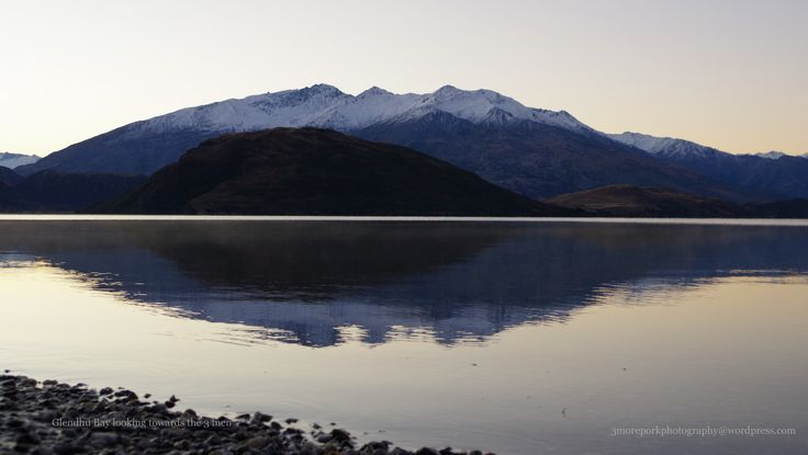 Snow capped mountains reflecting on Lake Wanaka, South Island, New Zealand