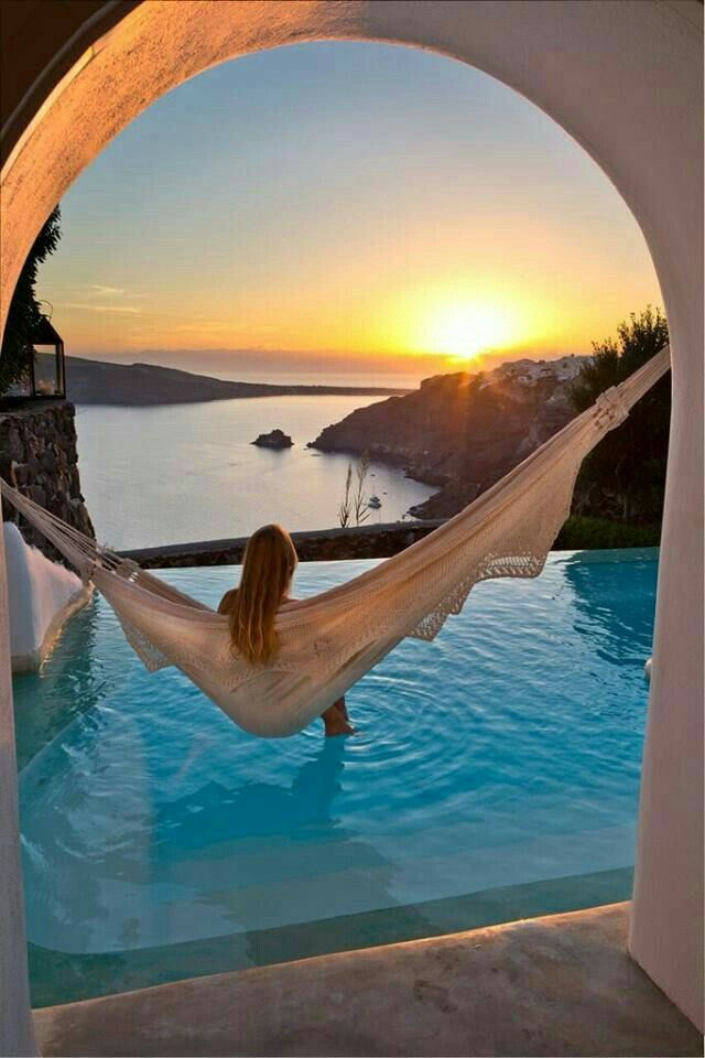 I need to be here!!!! Sitting on a hammock on top of a pool and watching the sunset is just what I need, definitely on my bucket list!